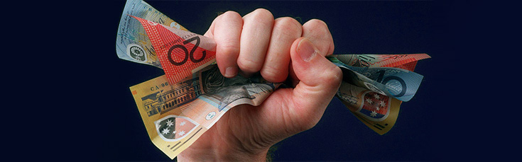 fist holding $80 in Australian currency